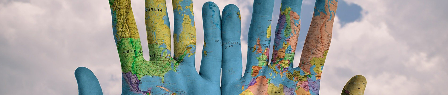 World map painted on a pair of hands
