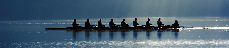 Eight-man crew on calm blue water